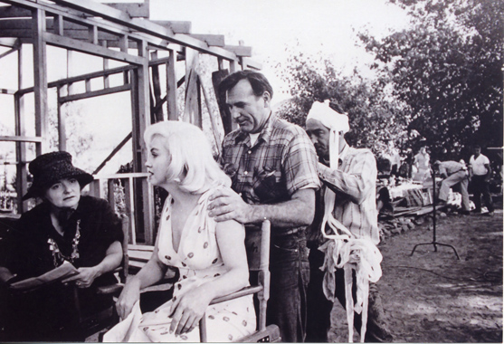 Paula Strasberg, Marilyn Monroe, Ralph Roberts, and Montgomery Clift massaging