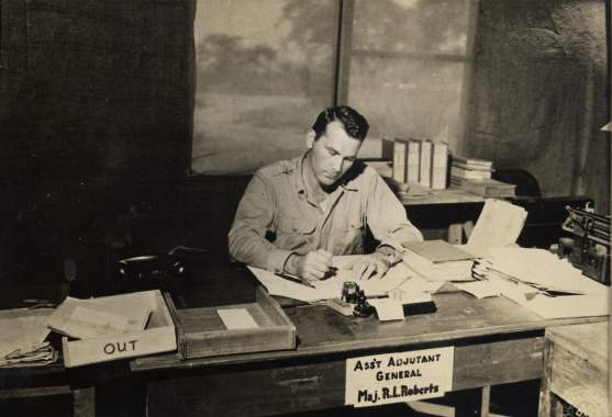 Ralph at his desk in Burma